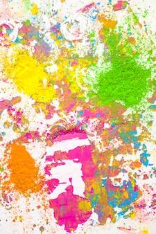 Tas de couleurs sèches orange, jaune, vert et violet