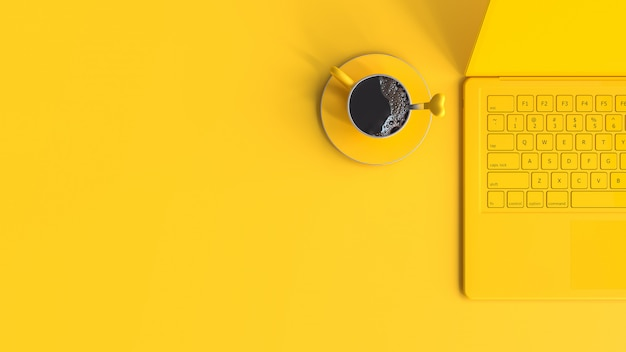 Tasse de café jaune à côté de l'ordinateur portable sur la vue de dessus de bureau de travail et espace de copie