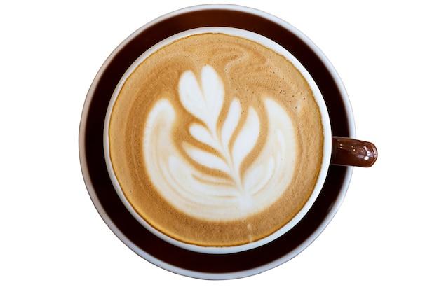 Tasse de café latte art sur vue de dessus de table isolée