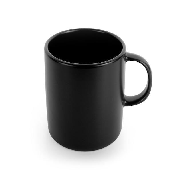 Tasse noire vide sur fond blanc