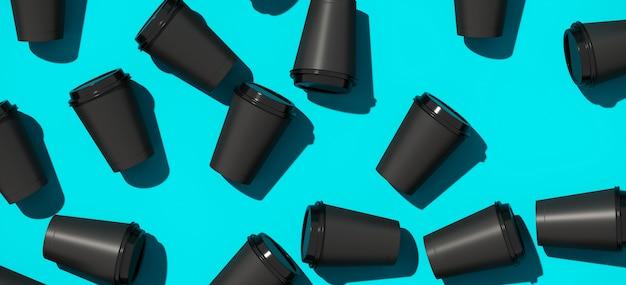 Tasse de papier café noir sur fond bleu