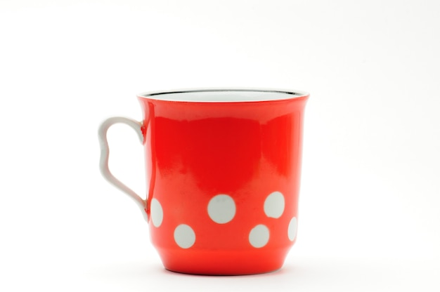 Tasse rouge vintage avec pois blancs