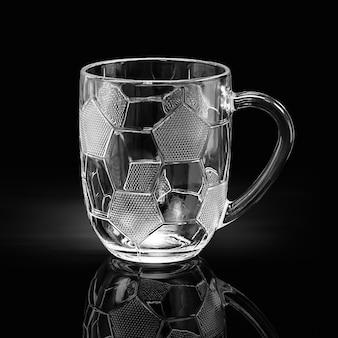 Tasse en verre vide avec motif ballon de football