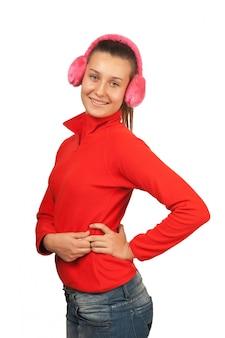 Teen fille heureuse dans un casque rose isolé sur blanc