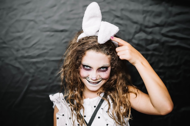 Teen girl with hare face paint