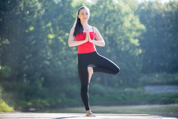 Teenage girl in vrksasana pose