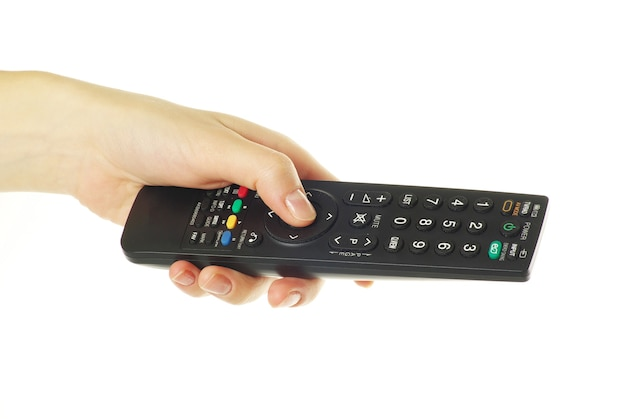Télécommande en main isolé sur fond blanc