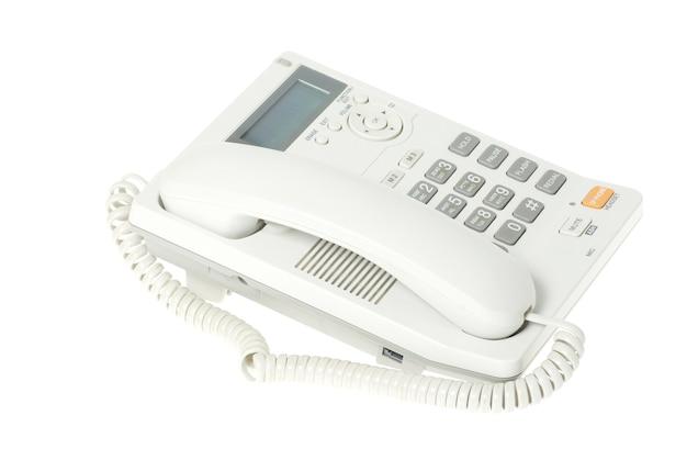 Téléphone de bureau blanc sur fond blanc