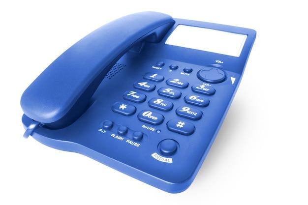 Téléphone de bureau bleu isolé sur fond blanc