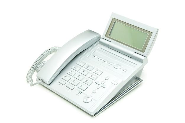 Téléphone de bureau gris rétro isolé sur un blanc