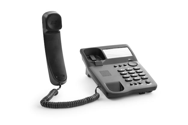 Téléphone de bureau noir avec le combiné soulevé vers le haut
