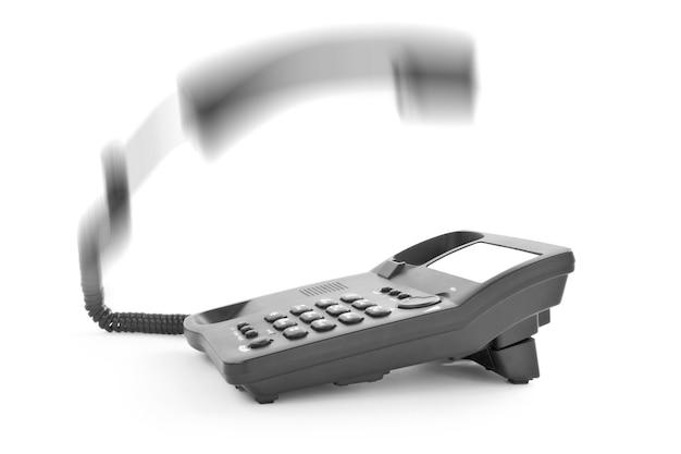 Téléphone de bureau noir concepts avec le combiné levé vers le haut