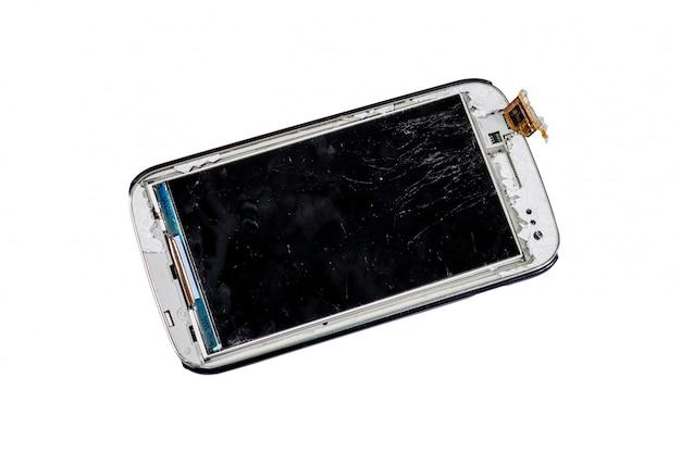 Téléphone intelligent cassé isolé