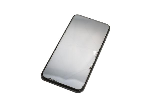 Téléphone intelligent avec écran cassé. isolé sur fond blanc. vue de dessus.