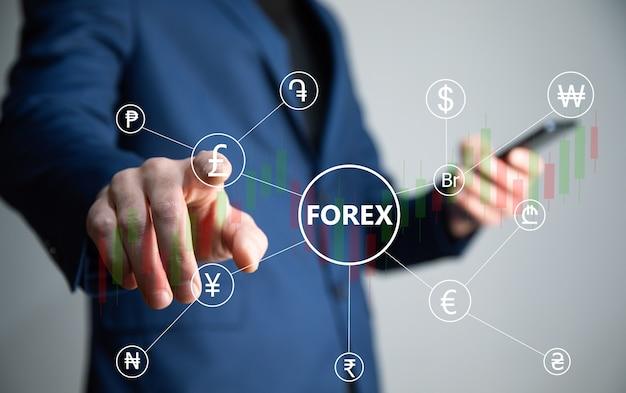 Téléphone de main de commerçant financier avec forex. concept forex
