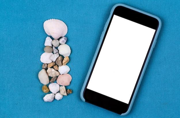 Téléphone mobile noir face avant avec coquillages