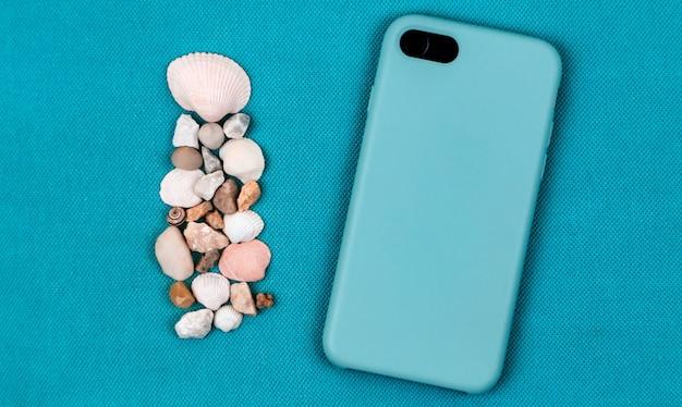 Téléphone portable arrière noir avec coquillages