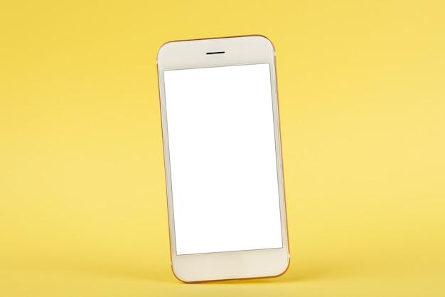 Téléphone portable, maquette, fond jaune
