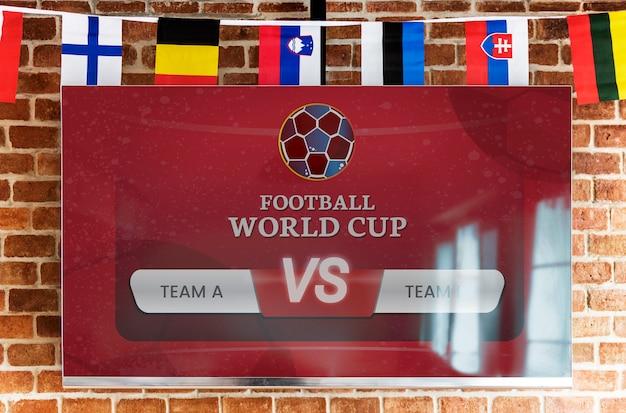 Télévision à écran plat avec match de football en direct