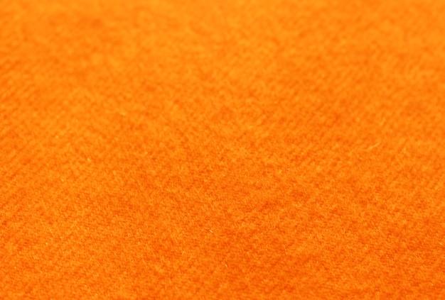 Tendance en tricot de laine orange rousse tendance, texture, gros plan