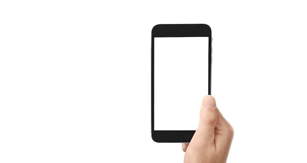 Tenez les téléphones mobiles, les appareils intelligents dans la main et la technologie d'écran tactile