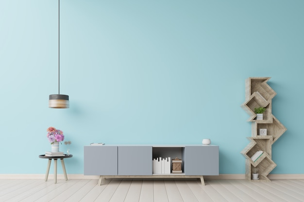 Tenez la télévision dans le mur bleu moderne de la salle vide.