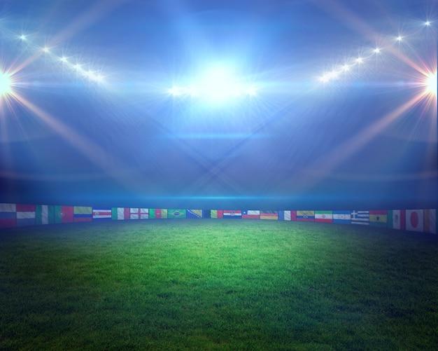 Terrain de football avec des lumières et des drapeaux