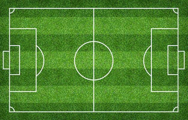 Terrain de football ou terrain de soccer pour le fond. cour de pelouse verte pour créer un jeu.