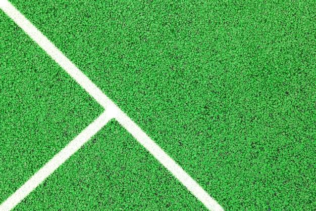 Terrain de sport ou fond de terrain de jeu. revêtement en caoutchouc artificiel pour terrains de jeux et lieux de sport de couleur verte