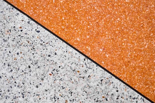 Terrazzo sol en pierre polie et fond de mur