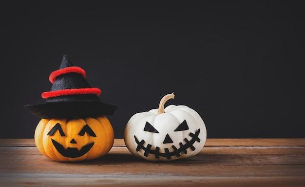 Tête de citrouilles fantôme jack lantern effrayant sourire porter chapeau