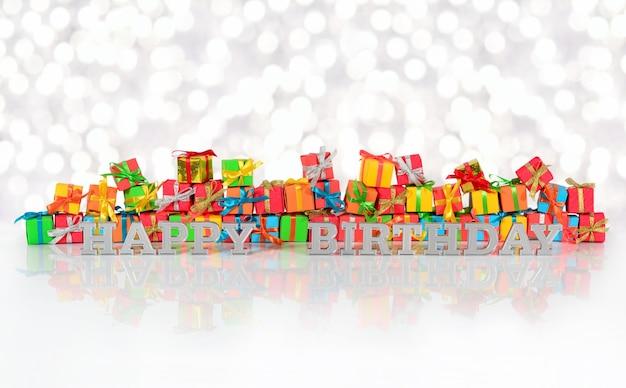 Texte argenté de joyeux anniversaire sur le fond des cadeaux multicolores sur un fond de bokeh