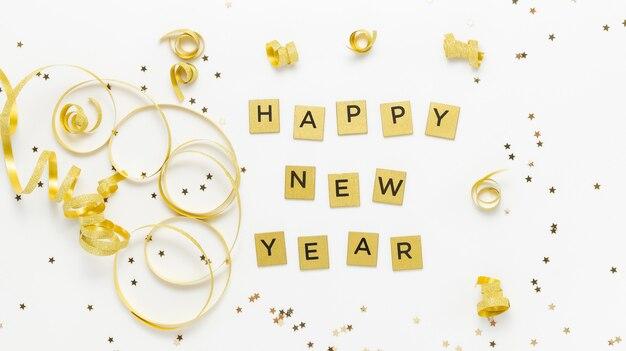 Texte de bonne année fait de lettres dorées avec des rubans dorés