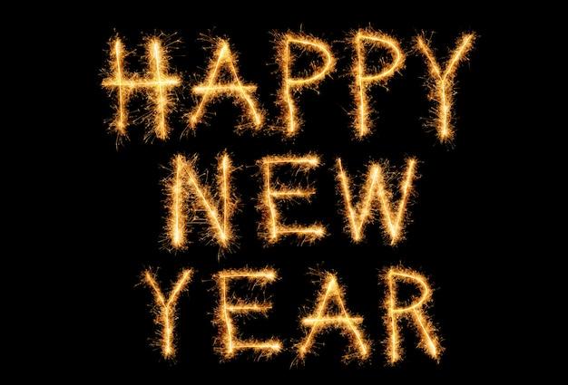 Texte de bonne année avec feux d'artifice sparkle isolé sur fond noir