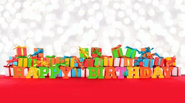 Texte coloré de joyeux anniversaire sur le fond des cadeaux multicolores sur un fond de bokeh
