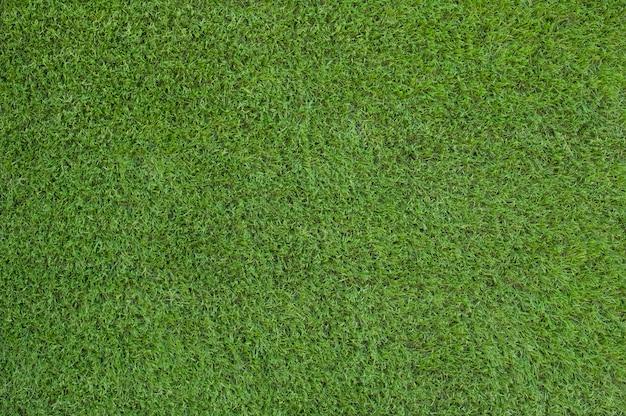Texte et fond d'herbe verte artificielle