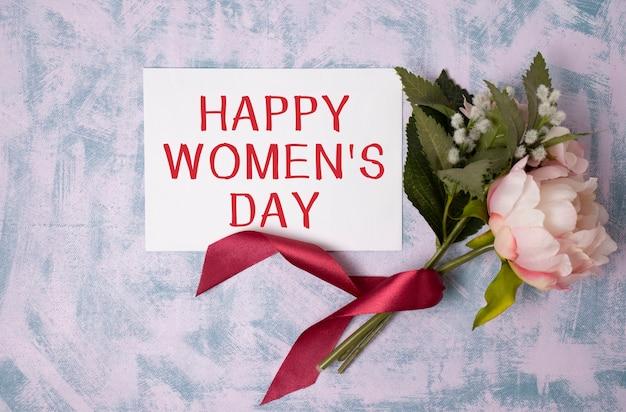 Texte de la journée de la femme heureuse avec bouquet de fleurs