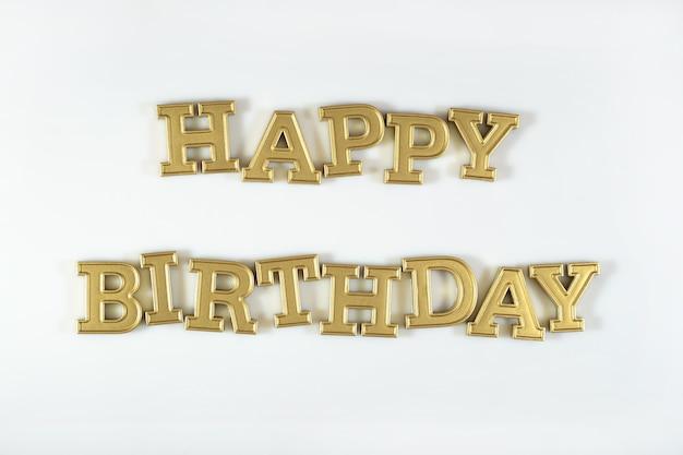Texte d'or de joyeux anniversaire sur un fond blanc