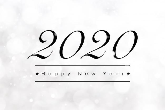 Texte de voeux de bonne année 2020 sur fond blanc bokeh