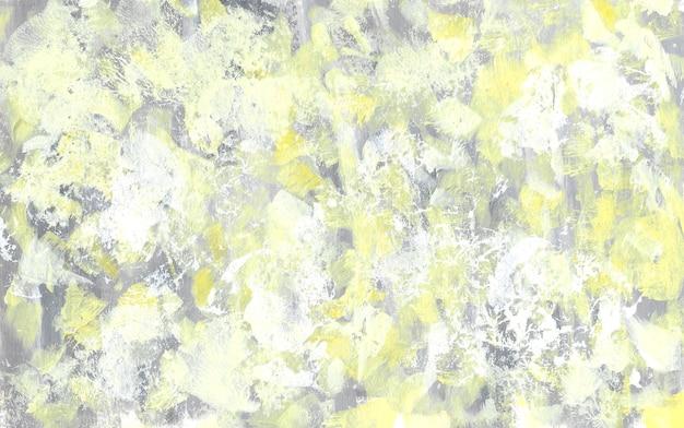 Texture abstraite jaune et grise. fond rugueux de gouache dessiné à la main. toile de fond de couleurs à la mode. peinture de coups de pinceau.