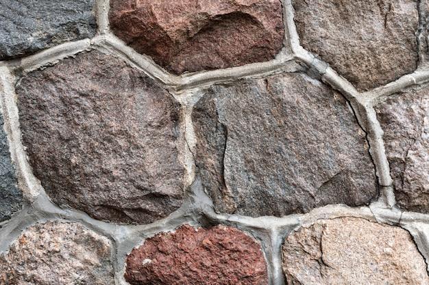 Texture abstraite de pierre de maçonnerie sur l'ancienne fondation de la cathédrale.