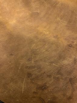 Texture agrandie de la peau brune, fond photo.
