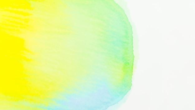 Texture aquarelle verte et jaune sur fond blanc