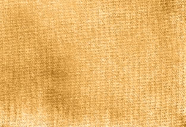 Texture d'arrière-plan peint à la main aquarelle pastel abstrait jaune foncé.