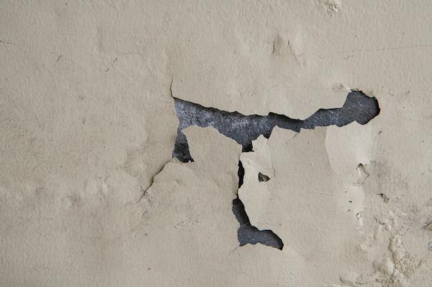 Texture d'arrière-plan de la peinture à gratter sur le vieux mur