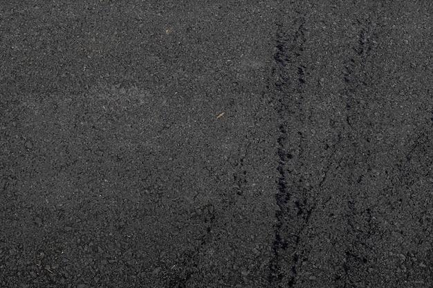 Texture et arrière-plan de la route asphaltée. mise à plat. vue de dessus