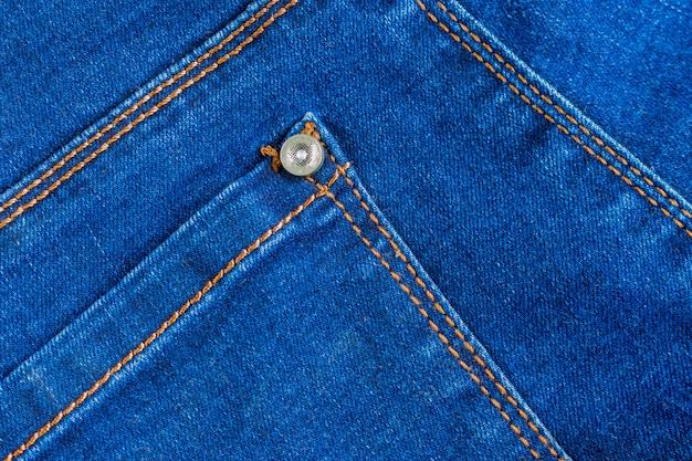 Texture d'arrière-plan tissu bleu véritable jeans denim.