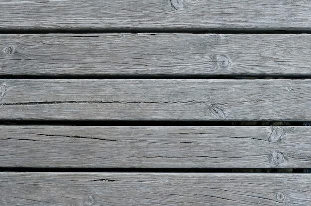 Texture d'arrière-plan vieille clôture en bois gris foncé