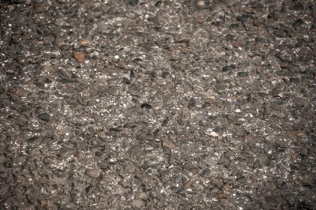 La texture de l'asphalte frais alignés de près. chaussée