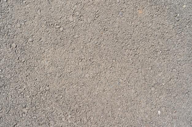 Texture asphalte gris foncé pour fond sombre. surface grunge rugueux d'asphalte, gris foncé sans soudure